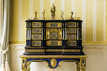 The ebonised table cabinet created in c.1875 from earlier elements, in the Drawing Room at Hinton Ampner, Hampshire.