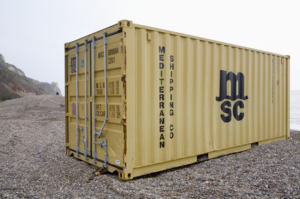 A container on the beach - The aftermath of the MSC Napoli shedding its cargo, now washed up on the beach at Branscombe, Devon