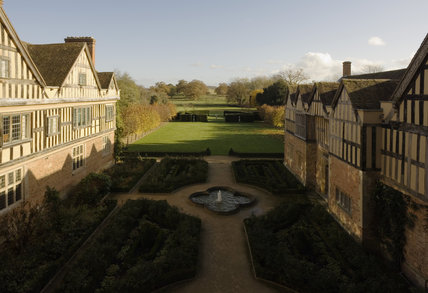 View over the courtyard of the exterior of Coughton Court, Warwickshire, taken from one of the windows