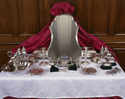The Countess of Stamford's toilet service, most of it made by Magdalen Feline apart from the candlesticks, snuffers and tray by John Quantock and the waiters by Richard Rugg
