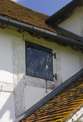 Small diamond pane window at Lower Brockhampton House, the medieval manor house on the Brockhampton Estate in Worcestershire