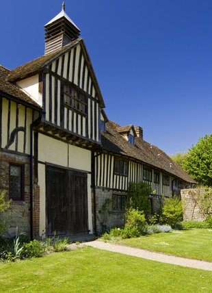 Centre of the range of he fifteenth-century Cottages with a dovecote on the gable, at Ightham Mote, Sevenoaks, Kent, a fourteenth-century moated manor house