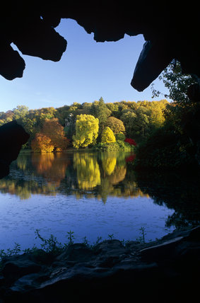 The view over the lake at Stourhead, Wiltshire from the Grotto in autumn