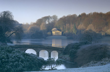 A wintry view at Stourhead, Wiltshire, over the Palladian Bridge with the Pantheon in the far distance
