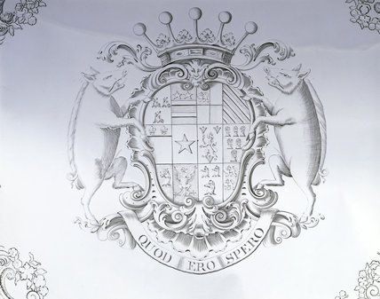 Detail of engraving of arms on a coffee table by James Shruder, 1741, (DUN.S.278) part of the silver collection at Dunham Massey, photographed for the Country House Silver book.