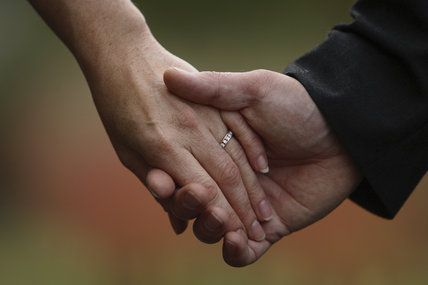 Wedding couple holding hands at Crom Estate, Co. Fermanagh, Northern Ireland. The estate is licensed for civil weddings.