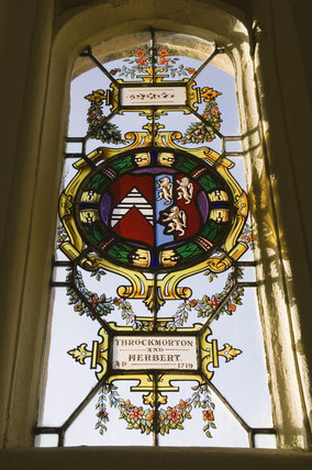 Detail of the lattice-paned windows with roundels and shields of heraldic glass commemorating the marriages of the Throckmorton family with other Catholic families, in the Drawing Room at Coughton Court, Warwickshire