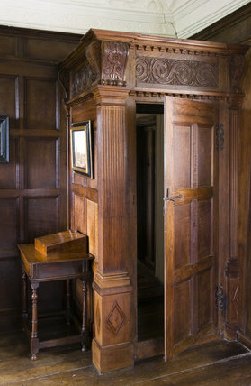 Wooden panelled porch in the Music Room at Westwood Manor, near Bradford-on-Avon, Wiltshire