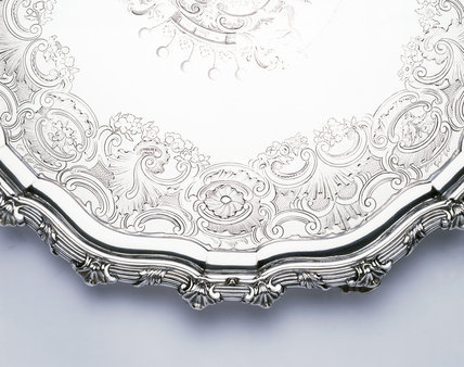 Detail of border of engraving on a coffee table by James Shruder, 1741, (DUN.S.278) part of the silver collection at Dunham Massey, photographed for the Country House Silver book.
