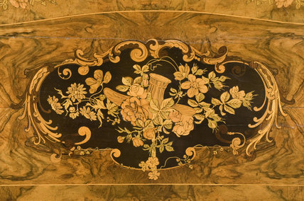 Walnut veneer games table marquetry top and gilt bronze decoration in the Drawing Room at Hughenden Manor, High Wycombe, Buckinghamshire
