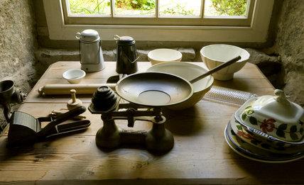 Weighing scales and baking equipment in the window bay n the Kitchen at Plas yn Rhiw, Pwllheli, Gwynedd