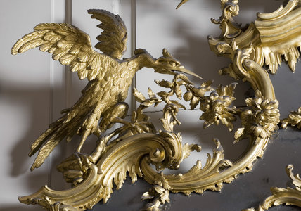 Detail of the bird decoration on the giltwood pier glass and table (1755-1760) attributed to Whittle & Norman, in the Red Room at Petworth House, West Sussex