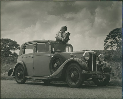Edward Chambré Hardman with Camera and Car