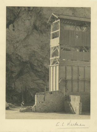 Unidentified Wooden Building with Cliff