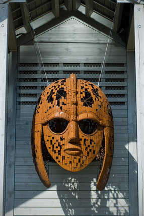 The striking Anglo Saxon warrior's helmet motif on the front of the exhibition hall at Sutton Hoo, the Anglo-Saxon royal burial site, Woodbridge, Suffolk