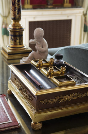 The Regency inkstand on top of the George III mahogany desk in the Sitting Room at Hinton Ampner, Hampshire