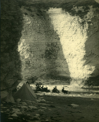 Group of Boys Camping next to Cliffs