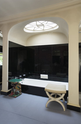 The Bathroom Showing The Bath In The Black Tiled Alcove At