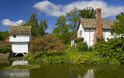 The small Gatehouse over the moat and Lower Brockhampton House, the medieval manor house on the Brockhampton Estate in Worcestershire