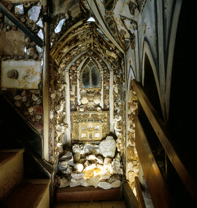 The Grotto on the staircase landing of the Shell Gallery, with glass window above quillwork and doll's house facade