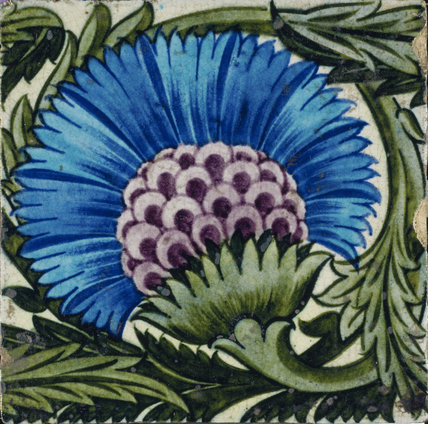 Large blue flower tile by de Morgan with claret centre and green surrounding foliage