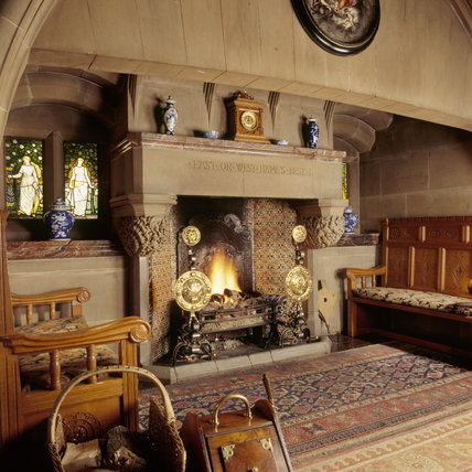 The Inglenook in the Dining Room with Gothic arch with carved stops