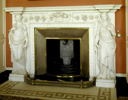 The library chimney-piece incorporates the figures of Pomona and Ceres, the roman goddesses of fruit and of the earth; attributed to Sir Richard Westmacott, (1775-1856)
