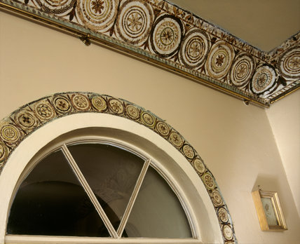 Feather cornice and door surround in the Drawing Room
