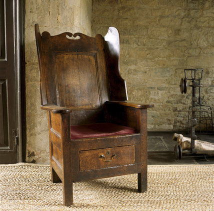 The Old Kitchen at Woolsthorpe Manor showing a close view of the eighteenth-century elm rent chair, so called because of the drawer beneath in which rents were placed when brought in