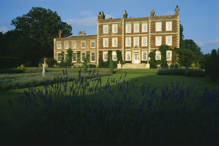 View of the front entrance of Gunby Hall with lawns and lavender beds in the centre and in the foreground