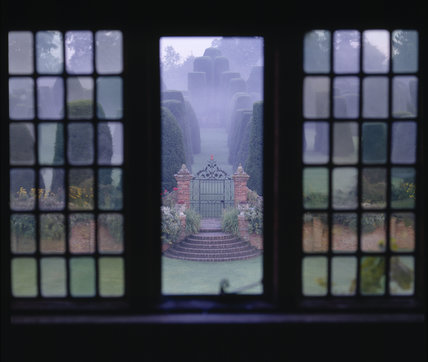 Looking out from a window of Packwood House to the misty Yew Garden, popularly known as