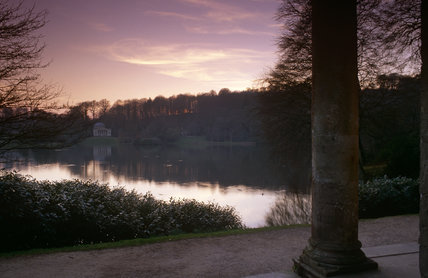 A distant view of the Pantheon from the Temple of Flora at sunset, Stourhead, Wiltshire
