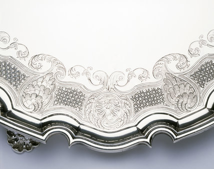 Detail of border of engraving on a tea table by David Willaume, 1741/2, (DUN.S.277) part of the silver collection at Dunham Massey, photographed for the Country House Silver book.