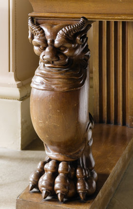 Detail of carved wooden table leg depicting a mythical creature with splayed toes, in the Entrance Hall at Ickworth, Suffolk