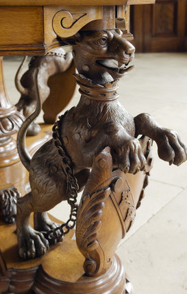 Detail of carved wooden table leg depicting the Hervey snow leopard, in the Entrance Hall at Ickworth, Suffolk