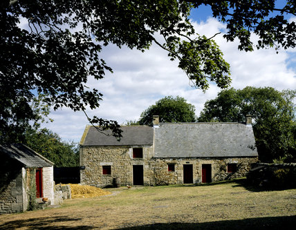 Close view of the birthplace of Thomas Bewick at Cherryburn from across the farmyard, showing the front of the house built of rough sandstone with dressed stone window and door surrounds