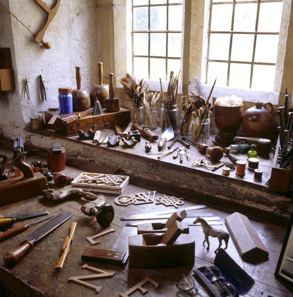 Partial view of the workshop bench in the Priest's House at Snowshill containing woodworking tools used by Charles Wade