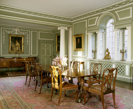 The Dining Room taken from the south-west corner showing the Venetian window, C.18th Cumberland dining table and Chippendale chairs at Croft Castle.