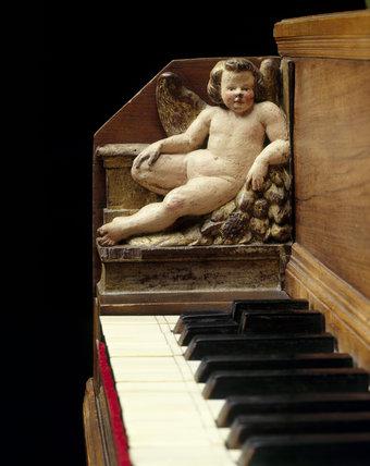 Carved cherub on keywell of 1590 (Anonymous) Italian harpsichord at Fenton House