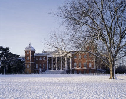 Angled view of the East front of Osterley Park taken in winter, with snow covering the ground and a tree in the foreground