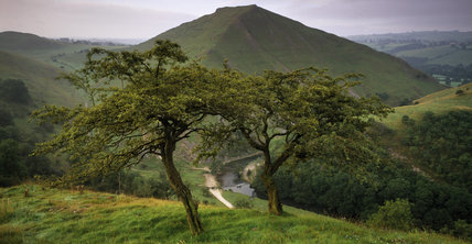 The River Dove carves its way through Dovedale at Thorpe Cloud, within the South Peak Estate