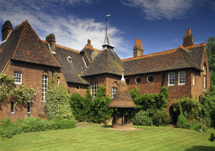 The east front of Red House with well in the foreground
