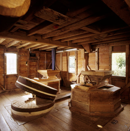 The first floor of the Mill showing some of the equipment for the milling process, including a pair of millstones exposed for inspection