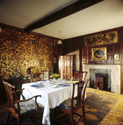 The Dining Room with the table set for a meal and showing the Cordoba wall covering