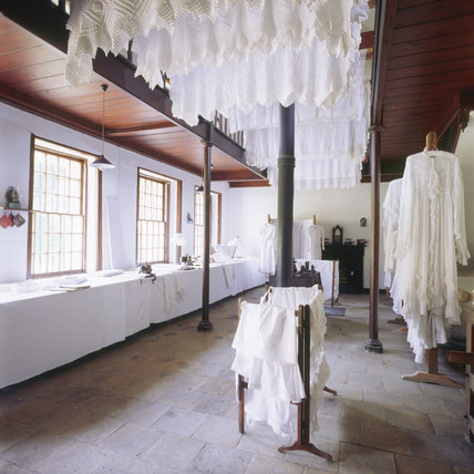 The Laundry with many washed articles hanging up to dry