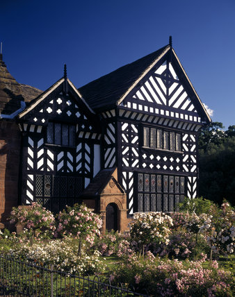 A close view of part of the house showing details of the black and white timber