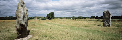 A panoramic view from the top of West Kennet Avenue looking north-west towards Avebury showing in the foreground two large Neolithic stones forming part of the prehistoric circle