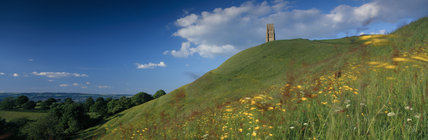 A panoramic view of Glastonbury Tor in Somerset, showing the 15th Century Tower of St Michael