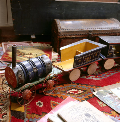 Partial view of a train set with locomotive pulling wagons inscribed 'N & YR' in Seventh Heaven at Snowshill Manor