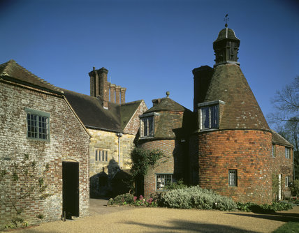 The late-eighteenth century Oast Houses at Bateman's, East Sussex, surmounted by a dove-cote